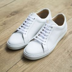 Made from Italian calf leather, these sharp white sneakers are bound to enrich your footwear collection.