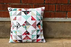 Nordika Half-Square Triangle Pillow by Jeni Baker, via Flickr