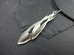 """SS Pendant with Cast Parts from hand-fabricated design, twisted to fit one another SS.PN0101on16""""RCN.13"""