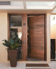 Versatility defines wooden doors as they come in a variety of styles, shapes and designs Informations About modern-wooden-front-door - Home Decorating Trends - Homedit Pin You can easily use my profil Wooden Front Doors, Modern Front Door, Front Door Entrance, House Entrance, Entry Doors, Front Entry, Modern Entrance Door, Sliding Doors, Timber Door