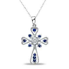 Ebay NissoniJewelry presents - Ladies .06CT Diamond Cross Pendant with Sapphire in 10k White Gold    Model Number:P6835A-W077SA    http://www.ebay.com/itm/Ladies-.06CT-Diamond-Cross-Pendant-with-Sapphire-in-10k-White-Gold/221630452951