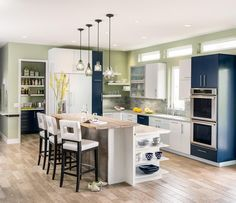 kitchen with color-blocked cabinets | Nesting Home Design