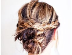 Everything is better with braids. Give a basic low bun a little personality by adding a pretty plait.