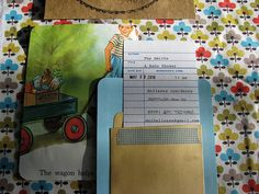 """""""Library card invitations are my fave"""" -- cute shower invitations created """"with the purchase of these library cards and pockets, some good old card stock, pages from old children's books, a date stamp and a typewriter."""""""