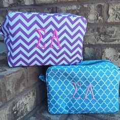Sigma alpha monogram clutch