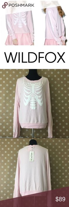 "Wildfox pink skeleton jumper NWT super comfy ""jumper"" as wildfox calls them , perfect sweatshirt to hang around or wear with your jeans fall is coming fast and so is Halloween season 🍁🎃 if unfamiliar with wildfox their clothes have a pre worn pilled effect * offers welcome, bundle 2 or more items in my closet using the ""bundle"" feature and receive 15% off of your total purchase! Wildfox Tops Sweatshirts & Hoodies"