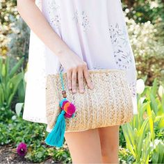 Pom poms + tassels + clutch = our Veronica Clutch! Pick this baby up at @bevello #clutchcrush
