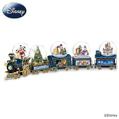 """Miniature Snowglobe Christmas Train With Disney Characters Disney Wonderland Express Train Collection Festive Disney characters inside 5 miniature snowglobes sit atop sculpted train cars with Disney art on sides. Plays """"We Wish You a Merry Christmas."""" Measure 3-1/2"""" to 4-1/2"""" W Price: $24.99 US Each Issue"""