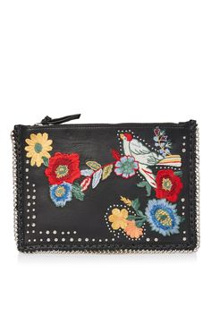 Embroidered accessories are a must-have for ss17. This black cross body bag comes with pretty floral detail to the front and is finished with edgy stud and metal chain detail.