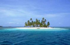 San Blas Islands, Panama.  These 365 islands are home of the Kuna people.  The islands vary in size but most appear to be posing for calendars.  Gorgeous and great snorkeling.