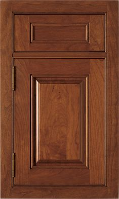 Hancock Raised door style by #WoodMode, shown in Fireside finish on cherry.
