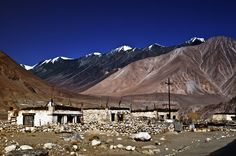 https://flic.kr/p/aHS12a | Durbuk | Durbuk was an old trading outpost in the seasonal flow of cattle and salt and other goods when nomads and traders traversed the vast barren Himalayan desert scape between Tibet and India.  The old Durbuk hamlet is tucked away from the road side and lies close to the river Shyok. This is a typical old style house with stones and mud as the mix with  square frames for doors and windows.The modern day additions are the electricity pole and the occasional…