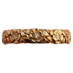 Tiffany & Co. Diamond Gold Flower Band Ring | From a unique collection of vintage band rings at https://www.1stdibs.com/jewelry/rings/band-rings/