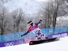 Valery Kolegov of Russia competes in the Snowboard Men's Parallel Giant Slalom Qualification. Sochi 2014 Day 13 - Snowboard Men's Parallel Giant Slalom. © 2014 XXII Winter Olympic Games.