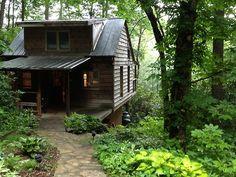 Dark cabin in the deep woods.