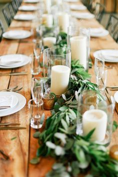 The head table will feature a runner of greenery (silver dollar eucalyptus, magnolia leaves and Italian ruscus) accented by varied heights of pillar candles in clear glass cylinders and varied heights of copper mercury glass votives....stemfloral.com | barrmansion.com | featherandtwinephotography.com: