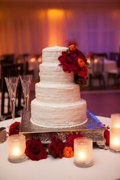 Fall Wedding Cake: deep red & warm with candles