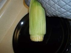 Never shuck corn again. Cut an inch off the wide end and the corn slips right out...no silks! How did I not know this?!