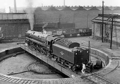 The last steam loco to be overhauled at Crewe Works Britannia 70013 (Oliver Cromwell) sadly without nameplates on the turntable at Patricroft, 7/66.