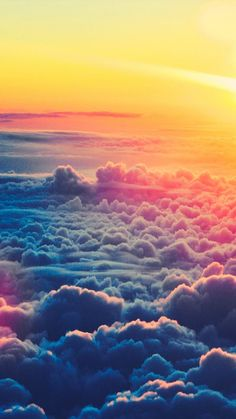 Full spectrum sunset over the clouds. Aerial photography. Flying over the clouds. Traveling.