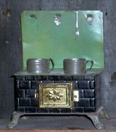 """Green and Black German Tin Stove with Lion's Paw Feet and 2 Permanently Placed Stew Pots, 6½"""" high"""