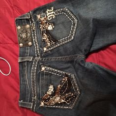 Miss mes size 25 inseam 31 Pretty much brand new! My best friend got them for me but they are too small. Willing to sell for $50 but preferably I want to trade for a 26 Miss Me Jeans Straight Leg