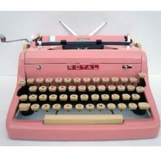 Vintage typewriter (in pink!) I wish I had one now.