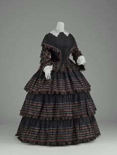 Day dress, silk taffeta with striped border trimmed with silk fringe, ca. 1855, American.