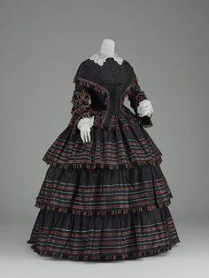 Day dress, silk taffeta with striped border trimmed with silk fringe, ca. 1855, American.