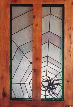 Web + Shimmering Iridescent Black Widow Spider stained glass by Elaine Prunty. Like the continuous web between the two panes and the glass choice for the spider's body.