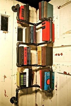 Pipes bookshelf- for games/bibles (what's in those cupboards?)