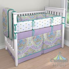 Girl Crib bedding in White Minky Chenille, Aqua and Purple Jasmine, Solid Emerald Turquoise, Purple Dots, Lime and Turquoise Puffs. Created using the Nursery Designer® by Carousel Designs where you mix and match from hundreds of fabrics to create your own unique baby bedding.