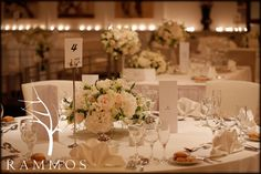 Wedding centerpiece - Wedding in Corfu Island  Floral decoration : Rammos-Floral Structures Photography : Studio 74 , Thanassis Rapsomanikis