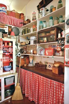 Curtains can hide a multitude of sins Gingham curtains instead of pantry doors! Cheap and pop of color.