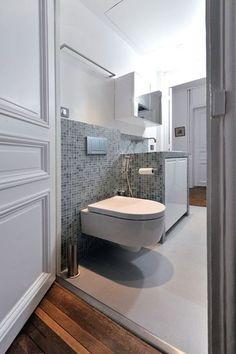 Des cloisons de salle de bains en briques de verre leroy for Petite salle de bain avec toilette