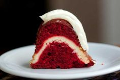 red velvet cream cheese bundt cake; must try; super moist red velvet bundt (oil based) filled with the most amazing cheesecake swirl (made with cream cheese, sour cream, heavy cream, sugar, and an egg) topped with a cream cheese sour cream frosting