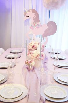 Loving the table settings and centerpiece at this Unicorn Birthday Party!! See more party ideas and share yours at CatchMyParty.com