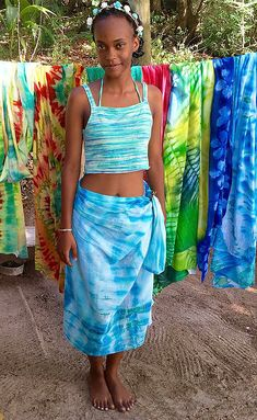 Kreol girl wearing African tie and dye pareo sarong Seychelles 103453ea2