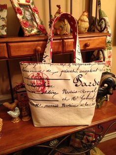 Finished another Christmas gift. Love the French script with red stamp fabric. I purchased the fabric from a shop on etsy.