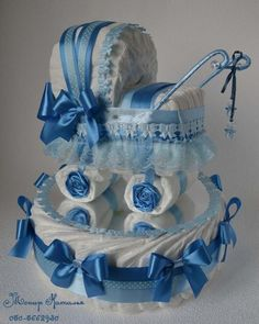 diaper cake centerpieces: Before you decide to buy services for your baby shower, sign up to a credit card which offers incentives and rewards. Since you're prone to run up a good bill footing your baby shower day, having a credit card that offers you miles or any other cheap deals is vital.