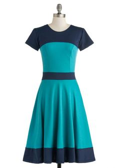 ModCloth: Nothing Like the Teal Thing Dress Your friends almost mistake you for an elegant illusion when you meet them for lunch in this colorblock dress - its gorgeous A-line silhouette is a whimsically radiant sight to see! Featuring a gracefully tailored bodice, short sleeves, and a visionary color combination of navy and teal, this mid-length frock's beauty is hard to believe.