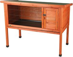 Give your small animals a place to call home with the Trixie Natura 1-Story Rabbit Hutch. Constructed from solid wood with a glazed pine finish, this hutch will endure years of use with very little maintenance. There's a retreat that offers privacy when it's time for a snooze, and the hinged roof gives you easy access inside, with locking arms so it can stay open when you want to let in some breeze. A pull-out plastic tray makes cleaning quick and easy, and the two doors with a metal slide…