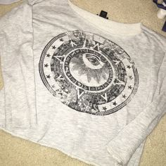 """grey lightweight eye cropped sweater lightweight &I cropped. darker grey in person. has a """"distressed"""" cut to it Wet Seal Tops Tees - Long Sleeve"""