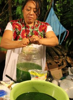señora con agua de chaya | can be made with pineapple and chaya.