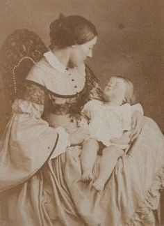 Photographing dead children was very common years ago during Late Victorian & Early Edwardian times. (1860 - 1910) Infant & child deaths were very common. It was a kind of photo-shoot ceremony & they used to prepare the dead body to get the best photogenic shots.