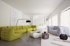 i am seriously in love with the new one-piece togo sofa (light blue) by Michel Ducaroy for ligne roset.
