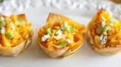 These Buffalo chicken macaroni and cheese cupcakes are filled with Buffalo flavor and lots of cheese. They're baked in wonton wrappers to hold all of that goodness in.