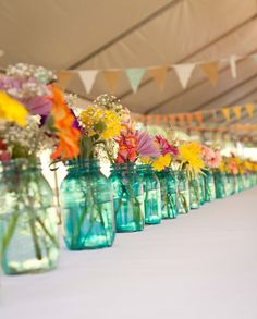 Bright and beautiful flowers in jars