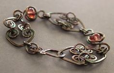 Heart to heart copper bracelet with raspberry color small lampwork glass beads.. $47.00, via Etsy.