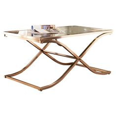 Showcasing a glass top and curving x-crossed chrome base, this chic coffee table makes a stylish resting spot for a tray of canapes or your latest read....